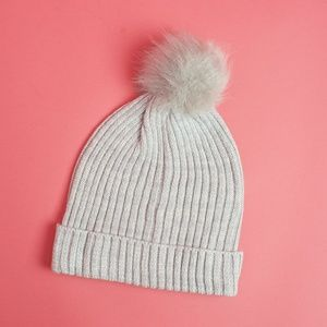 New Hat Attack ribbed hat with faux fur pom